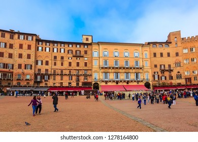 Siena, Italy - October 25, 2018: Panorama of Campo Square or Piazza del Campo with cafe, restaurants and people in Tuscany town