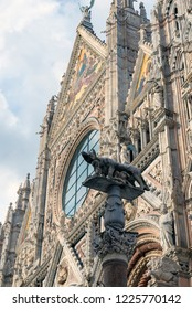 SIENA, ITALY - OCTOBER 27, 2018:  the Gothic facade of the Duomo of Siena, dedicated to Saint Mary of the Assumption