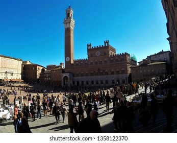 Siena, Italy – October 30, 2016: Pubblico Palace (Palazzo Pubblico) and Torre del Mangia in the Piazza del Campo in Siena