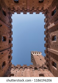 Siena (Italy) Tuscany - 08/18/2018 - Courtyard of the Podestà with a view of the Torre del Mangia.