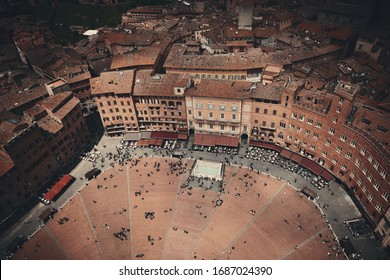 Siena Piazza del Campo rooftop view with historic buildings in Italy