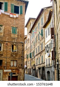 Siena street with typical antique houses. Siena, Italy