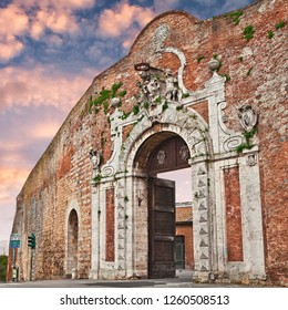 Siena, Tuscany, Italy: the city gate Porta Camollia at sunset in the medieval walls of the town