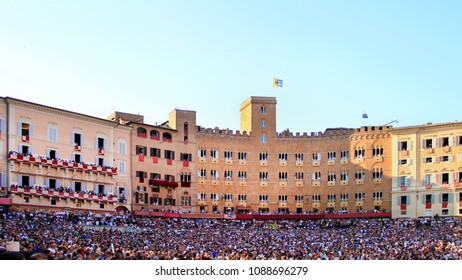 Siena, Tuscany / Italy - is held on 2 July 2015, on the Piazza del Campo, crowd on the Palio di Siena (named Palio di Provenzano, in honour of the Madonna of Provenzano) famous horse race.