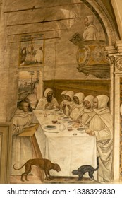 Siena, Tuscany - Italy, March 7, 2019. Abbey of Monte Oliveto Maggiore: Fresco rapresenting San Benedetto in the refectory with the community of monks