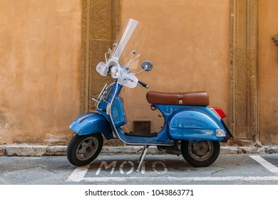 SIENNA, ITALY - 16 MAY 2016: Retro scooter on the street of Siena city