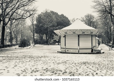 Sienna, Tuscany - March 01 2018: carousel closed in winter with the nenel city park of the city of Siena in Italy...
