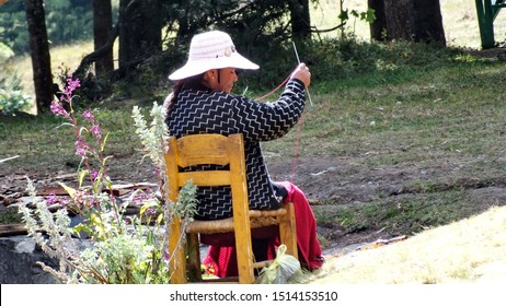 Sierra Chincua, Michoacan State, Mexico, January 14, 2015: A Native Mexican Woman knits at the main entrance to the Sierra Chincua Monarch Butterfly Sanctuary.