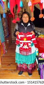 Sierra Chincua, Michoacan State, Mexico, January 14, 2015: A Native Mexican Woman displays a knitted sweater at the main entrance to the Sierra Chincua Monarch Butterfly Sanctuary.