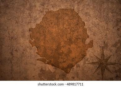 sierra leone map on a old vintage crack paper background