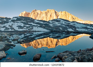 Sierra Nevada Alpenglow Reflection - Mount Hitchcock mirrors in a lake at sunrise.
