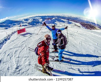 Sierra Nevada, Granada / Spain - January 1 - 2015: Fun travel adventure in Sierra Nevada Park skiing with friends.