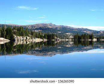 Sierra Nevada landscape reflected in Utica Reservoir on a windless day
