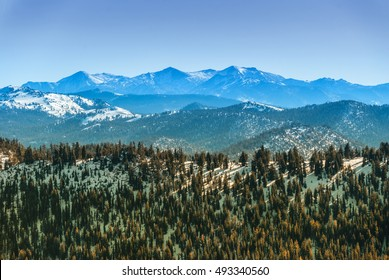Sierra Nevada mountain range in winter seen from the north side of the Lake Tahoe.