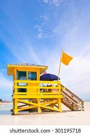 Siesta Key Beach on the west coast of Florida is famous for the fine white sand. Typical lifeguard house in bright color with a flag.