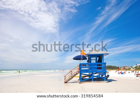 SIESTA KEY, FLORIDA USA-OCTOBER 4, 2013: Blue lifeguard house in Siesta Key on the west coast of Florida. Famous for pristine white sand beaches and sunny weather it attracts visitors all year round