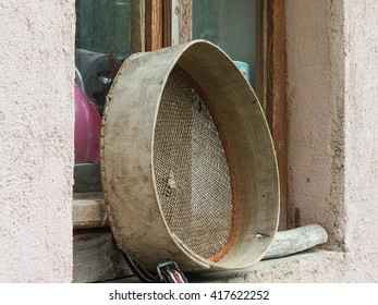 Sieve with a wooden frame front window