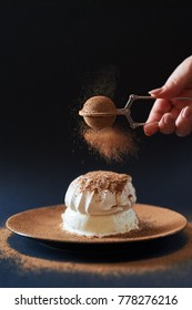 sifting cocoa powder on dessert