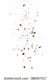 Sifting heavy ground black pepper over white background.