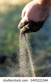 Sifting sands falling from a childs hand