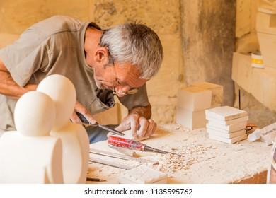 SIGGIEWI, MALTA - SEP 16, 2016: Stone Museum: master carver at work