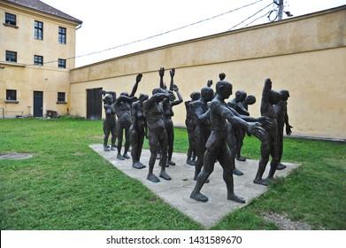 SIGHETU MARMATEIE, MARAMURES / ROMANIA - SEPTEMBER 2 2010: Sculptures depict naked political prisoners in the prison yard of Sighetu Prison at the Memorial to Victims of Communism.