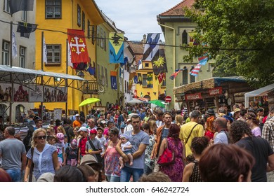Sighisoara, Romania - July 26, 2014: Large crowd of tourists come to visit the famous medieval citadel of Sighisoara, listed by UNESCO as World Heritage Site.
