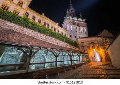 SIGHISOARA, ROMANIA - JULY 28,  2015: Night view of clock tower in historic Sighisoara Medieval City on July 28, 2015. Vlad Tepes, Dracula, was born here.