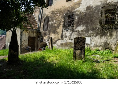 SIGHISOARA, ROMANIA - JUNE 19, 2019: Authentic tombstone in gothic style.