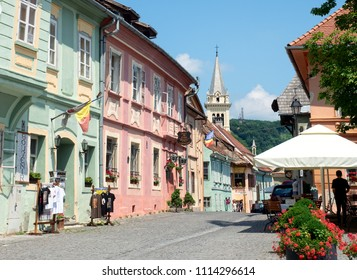 Sighisoara, Romania - June 27, 2017 : View of medieval old town in a sunny day.  Founded by the Saxons in the late 12th century, Sighisoara is listed as World Heritage Site by UNESCO