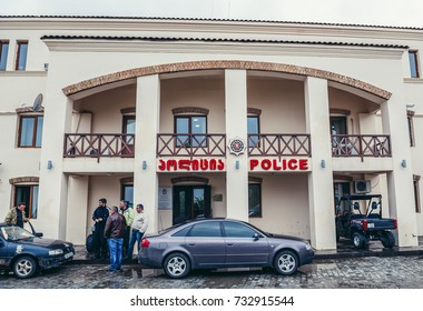Sighnaghi, Georgia - April 24, 2015. Group of men stands in front of police station in Sighnaghi town
