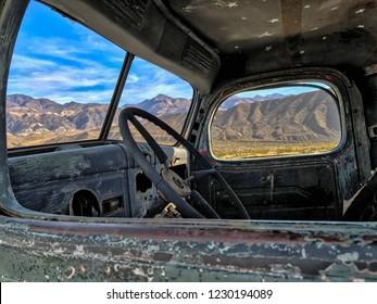A sight through the window of an old truck, Ballarat, Death Valley National Park, California, USA