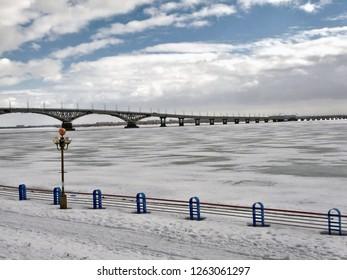 Sights of the Volga region. Road bridge across the Volga River in the snowy city of Saratov