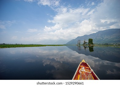 Sightseeing over Dal Lake using a shikara - a type of wooden boat. Shikara are of varied sizes and are used for multiple purposes, including transportation of people.