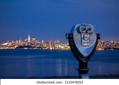 Sightseeing viewfinder at Vista Point near Golden Gate Bridge with San Francisco city skyline at night