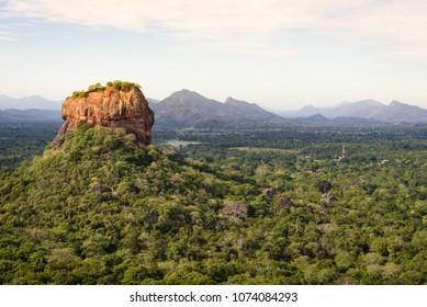 Sigiriya lion rock in Sri Lanka. The Sigiriya rock stands out of the sri lanka jungle seen from Pidurangala Rock near Dambulla, Sri Lanka