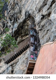 Sigiriya, Shri Lanka - January 29, 2019: People are climbing up the spiral staircase of Sigriya rock, Sigiriya, Shri Lanka.