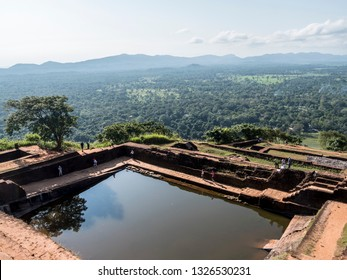 Sigiriya, Shri Lanka - January29, 2019: A typical hindu water basin on top of Sigiriya rock. And a beautiful view. Sigiriya, Shri Lanka.