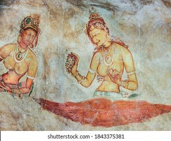 Sigiriya, Sri Lanka - August 9, 2005:  Sigiriya maiden - 5th century frescoes at the ancient rock fortress of Sigiriya in Sri Lanka