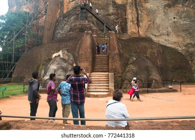 SIGIRIYA, SRI LANKA - DECEMBER 2017: The famous Lion's rock with used to host the ancient city and gardens of Sirigiya is now one of the most visited tourist spots of Sri Lanka