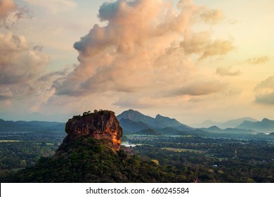 Sigiriya, Sri Lanka. Sunset over the Lion Rock in Sigiriya, Sri Lanka. Aerial view of the tropical forest with mountains