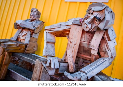 SIGLUFJORDUR, ICELAND - 15 August 2012: Sitting wooden statues with colorful background in Siglufjordur, Iceland