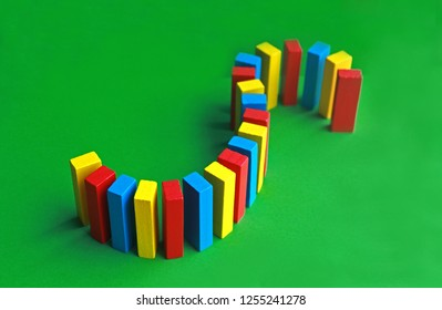 sigmoid serpent built with colorful toy blocks on a green surface