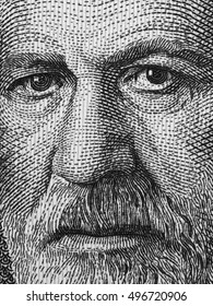 Sigmund Freud portrait on Austria 50 schilling banknote close up macro, black and white. Austrian neurologist and the founder of psychoanalysis.