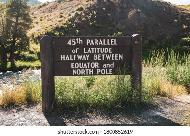 Sign - 45th Parallel of Latitude Halfway between Equator and North Pole sign in the North Entrance of Yellowstone National Park Wyoming
