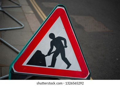 The sign about the road works in the city.