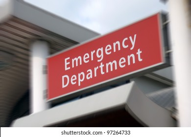 Sign above the Emergency Department in NHS hospital. Zoom effect centered on sign.