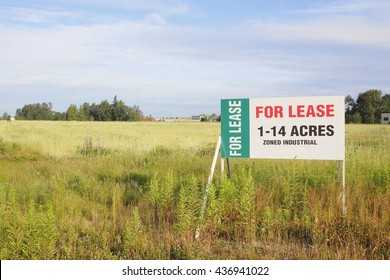 A sign advertises land acreages for lease/Leased Industrial Land/A sign advertises land acreages for lease.