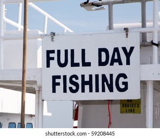 Sign advertising a fishing charter