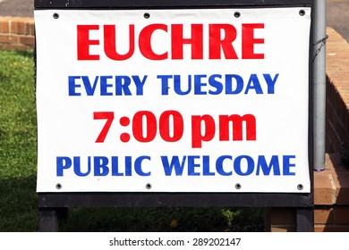Sign advertising a place to play Euchre with other interested card players.  Euchre is a card game usually involving 2 or 4 players.